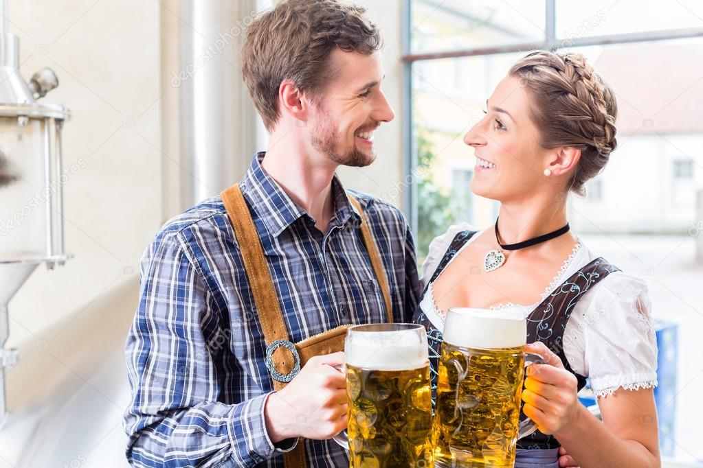 depositphotos_79104842-stock-photo-brewer-and-woman-toasting-in